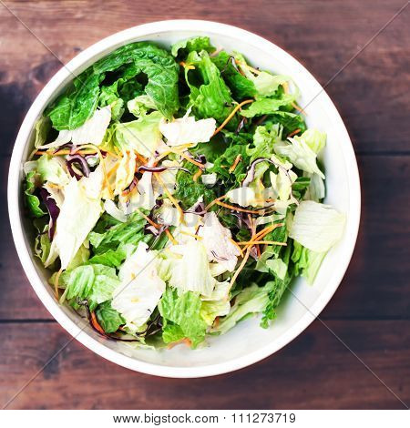 ..fresh Spring Salad With Rucola, Red Onion And Lettuce Leaves In White Bowl On Wood Background.