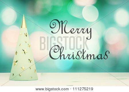 Merry Christmas Inscription With Menthol Christmas Tree With Golden Stars