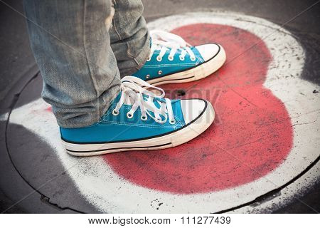 Blue Sneakers, Teenager Feet Standing On Sewer Manhole