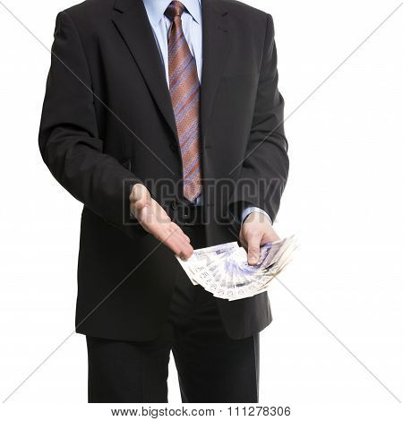 Businessman In Dark Suit Shows A Spread Of 20 British Pounds Sterling Banknotes