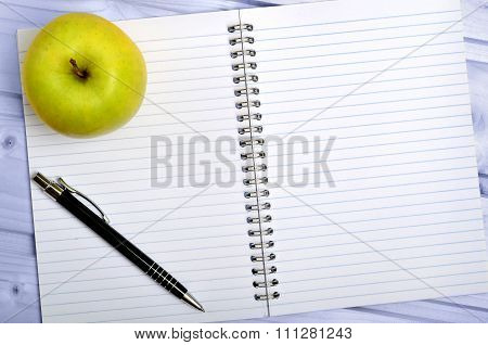 Notebook With Apple Fruit And Pen