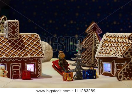 Christmas card with gingerbread house and tree