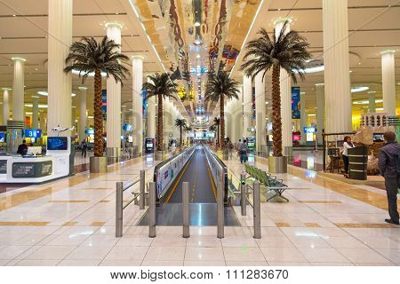 DUBAI, UAE - MARCH 24, 2014: Interior of terminal 3 at Dubai International Airport. This is the worlds largest airport terminal with over 1,713,000 m2 exclusively for Emirates airlines.