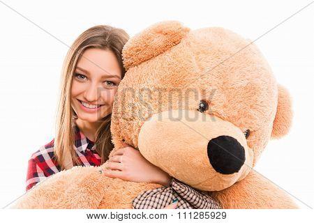 Cute Young Tenage Girl Hugs Her Teddy Bear