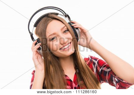 Portrait Of Smiling Girl In Head-phones Listening To Music