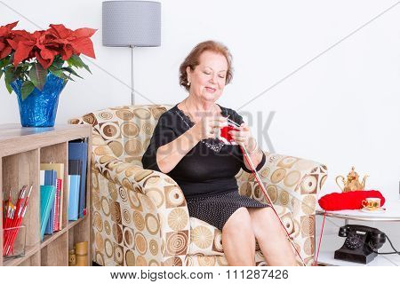 Happy Senior Lady Enjoying Her Knitting
