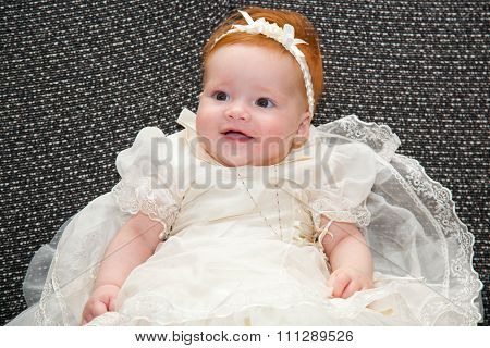 Baby In Baptismal Clothing