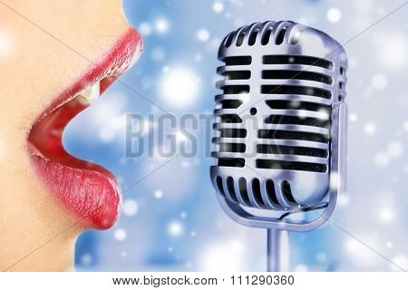 Singing woman and retro microphone over snow effect