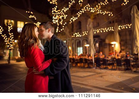 Young couple kissing on the street, relationships, love, people, birthday and holidays concept