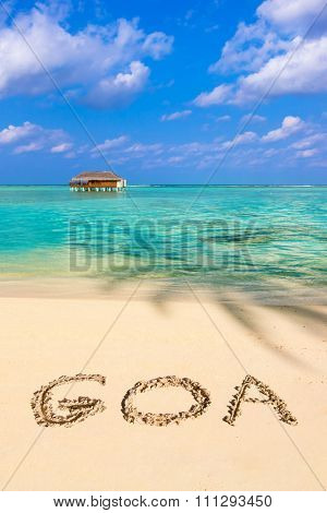 Word Goa on beach - concept holiday background