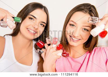 Beautiful Girls In Pajamas Holding Varnishes