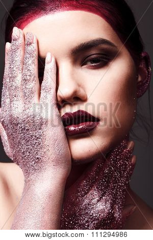 Studio Fashion Portrait Of Attractive Woman With Creative Make-up And Glitter And Spangle On Hands