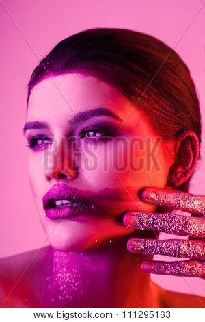 Studio Fashion Portrait Of Attractive Woman With Smeared Lipstick And Glitter And Spangle On Hands