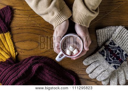Holding Hot Cocoa.