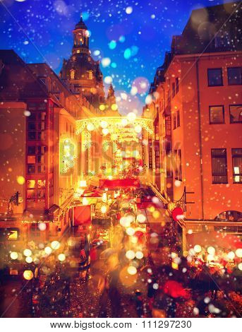 Traditional Christmas market at night. Street in a Christmas night in an old European town