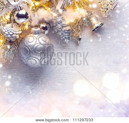 Christmas Holiday Background decorated with baubles, light garland and spruce with snow. Christmas and New Year Decoration art design