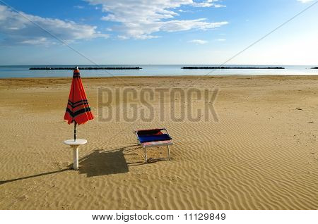 Beach umbrella and sunbed