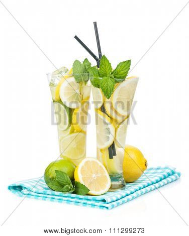 Homemade lemonade with citruses. Isolated on white background