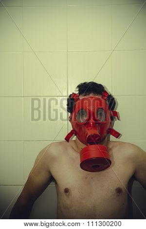loneliness naked man with red gas mask, blood, despair and suicide