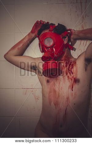 crime naked man with red gas mask, blood, despair and suicide