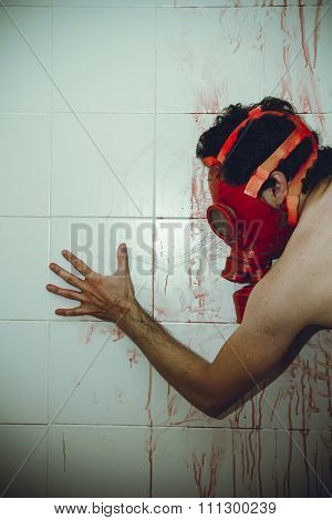 horro naked man with gas mask red blood in a bathroom