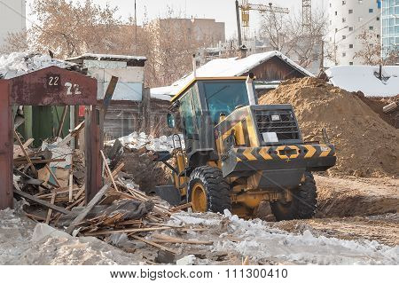 Tractor removes debris from building demolition