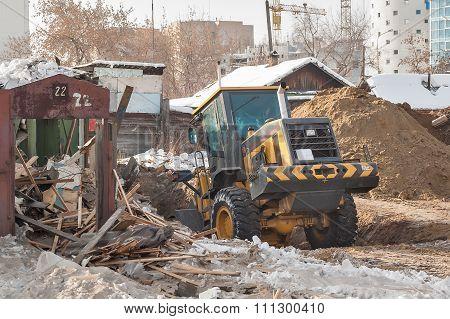 Tractor removes debris from building demolition