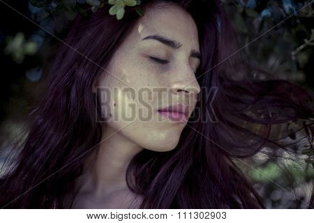 depression melancholic girl in a forest in autumn, red long hair