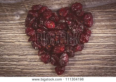 Vintage Photo, Heart Of Red Cranberries On Wooden Table