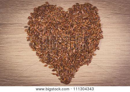 Vintage Photo, Heart Of Linseed On Wooden Background