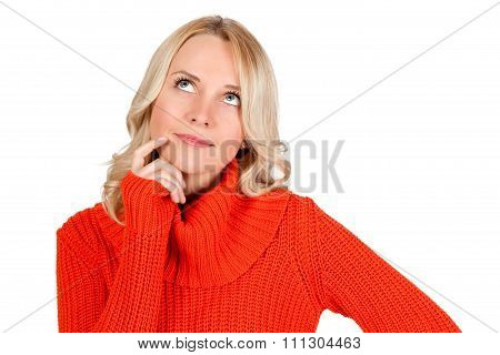 Blonde young woman is thinking