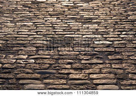 Old Road Paved With Granite Stones Texture As A Background