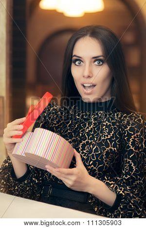Surprised Beautiful Woman Opening Heart Shape Gift