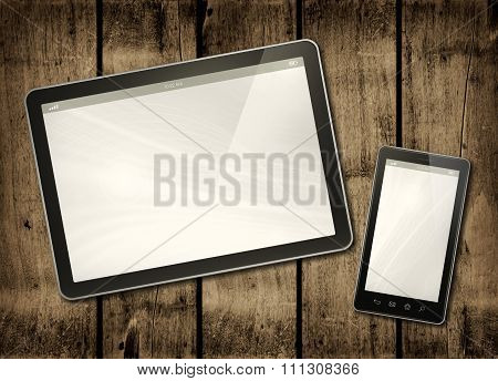 Smartphone And Digital Tablet Pc On A Dark Wood Table