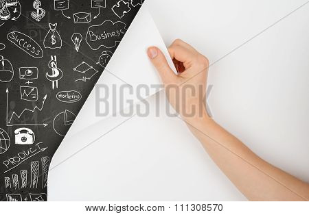Hand turns page and drawing concept on blackboard