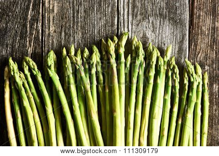 Bunch of asparagus over rustic wooden background