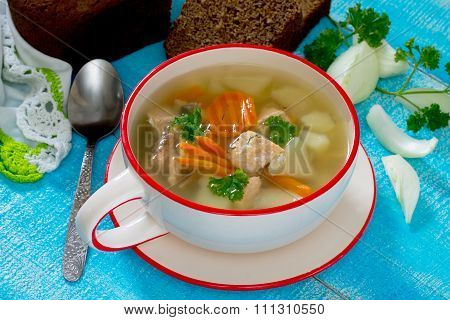 Ear Fish Soup Of Red Fish Salmon On A Wooden Background
