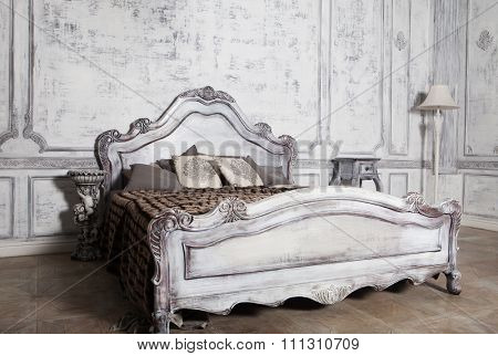 Interior of a bedroom , Romantic wooden bed, white tones.