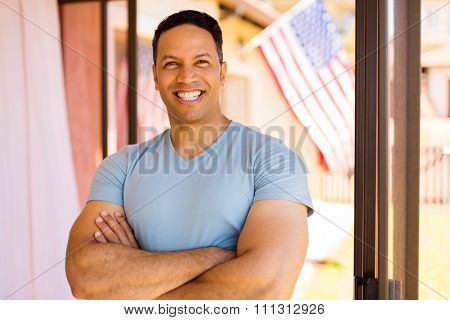 happy middle aged american man looking at the camera