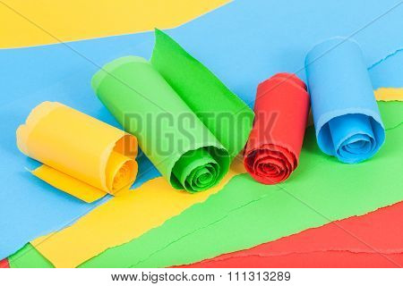 Rolled Colour Paper On Sheets Of Torn Paper
