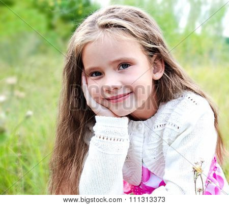 Portrait Of Adorable Little Girl In Summer Day