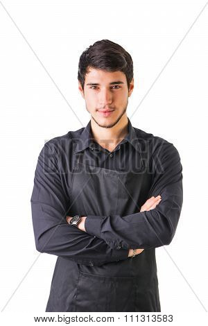 Young chef or waiter wearing black apron isolated