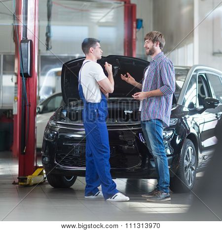 Auto Mechanic Talking With Client