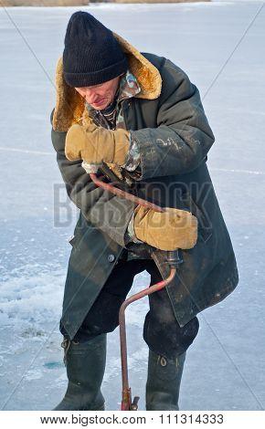 Old Man On Winter Fishing