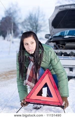 Winter Car Breakdown - Woman Warning Triangle
