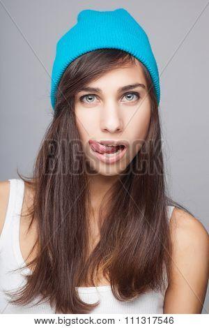 young beautiful girl posing grimacing