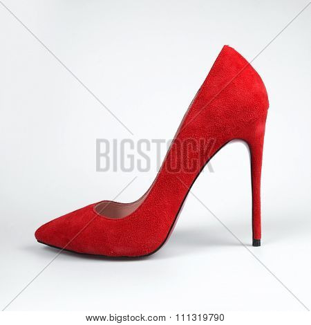 Pair Of Red Female Shoes On A White Background.
