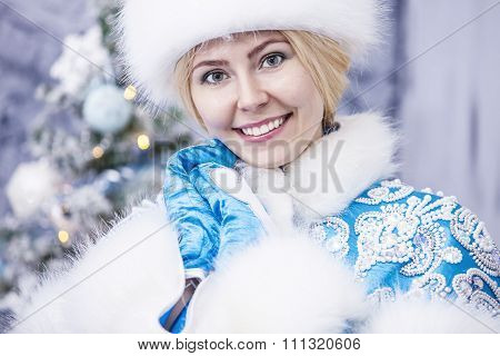 Portrait Of A Beautiful Woman Snow Maiden Close Up In Winter Clothes
