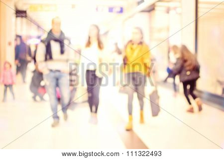 Blur People Shoping In Super Store With Bokeh Light Background.
