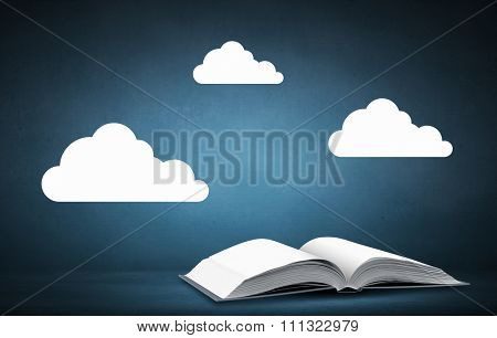Opened book with white clouds above pages